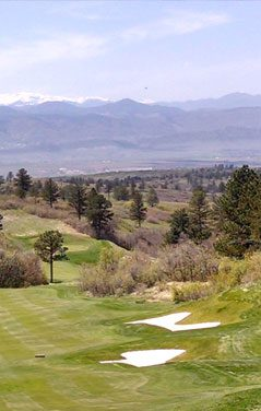 Beautiful mountains in the background with a golf course in the forefront